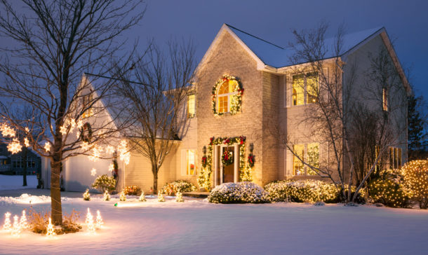 Snowy house with holiday lighting and decor