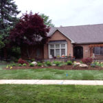 Residential landscaping front elevation with irrigation going