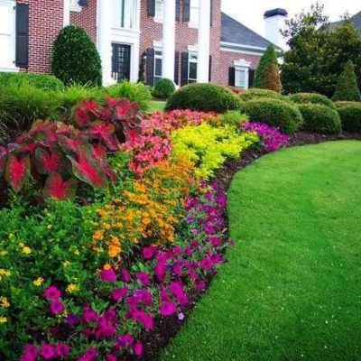 Well trimmed yard with flowers and green grass Land Visions Lansing Michigan
