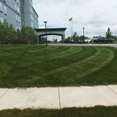 mowed lawn in front of a hotel Land Visions Lansing Michigan