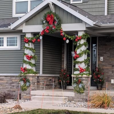 Entryway of home with wreath and holiday decorations Land Visions Lansing Michigan