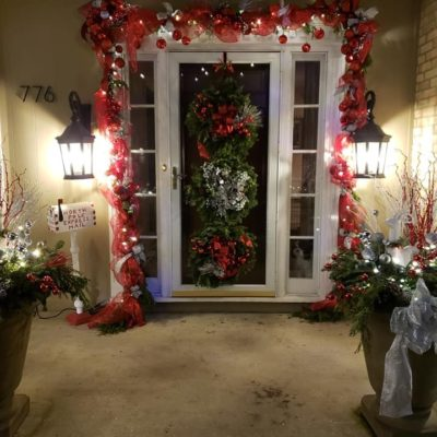 Front door of home three holiday wreaths Land Visions Lansing Michigan