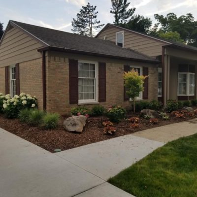 Landscaping in the front of a home Land Visions Lansing Michigan