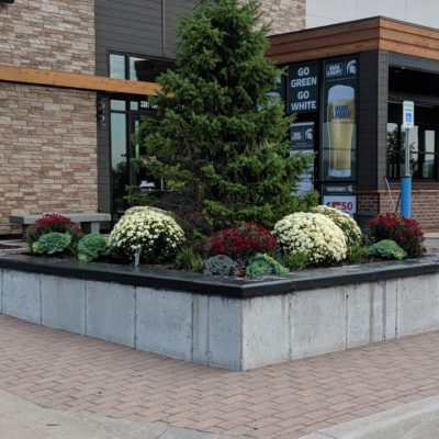 Entry way to pizza restaurant flowers and landscaping Land Visions Lansing Michigan